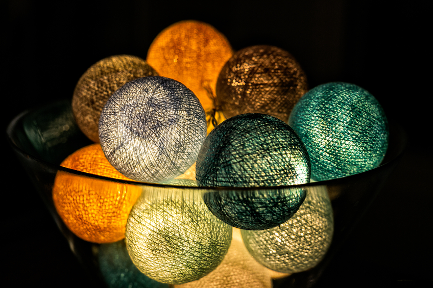 Decorative lights in a glass vase.