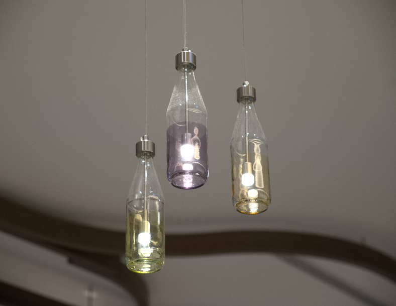 Lights hanging from the ceiling in bottles