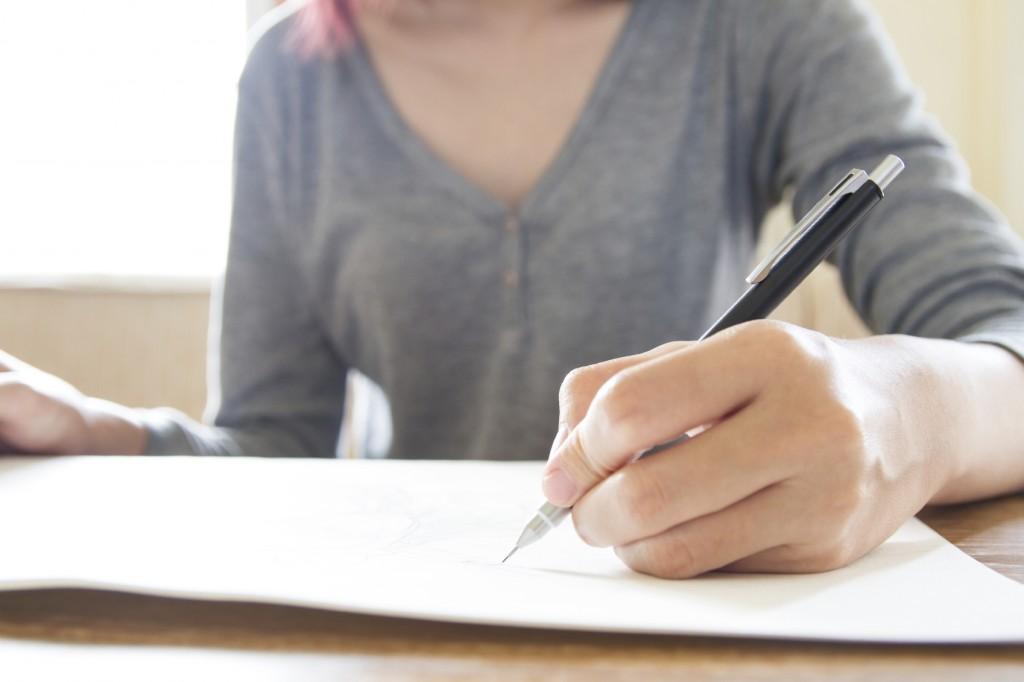 Woman hand using pencil drawing, sketching