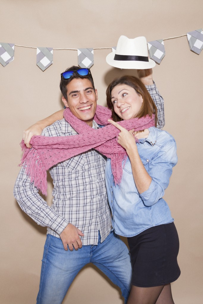 Young Couple in Photo Booth - iStock_000054513662_Large